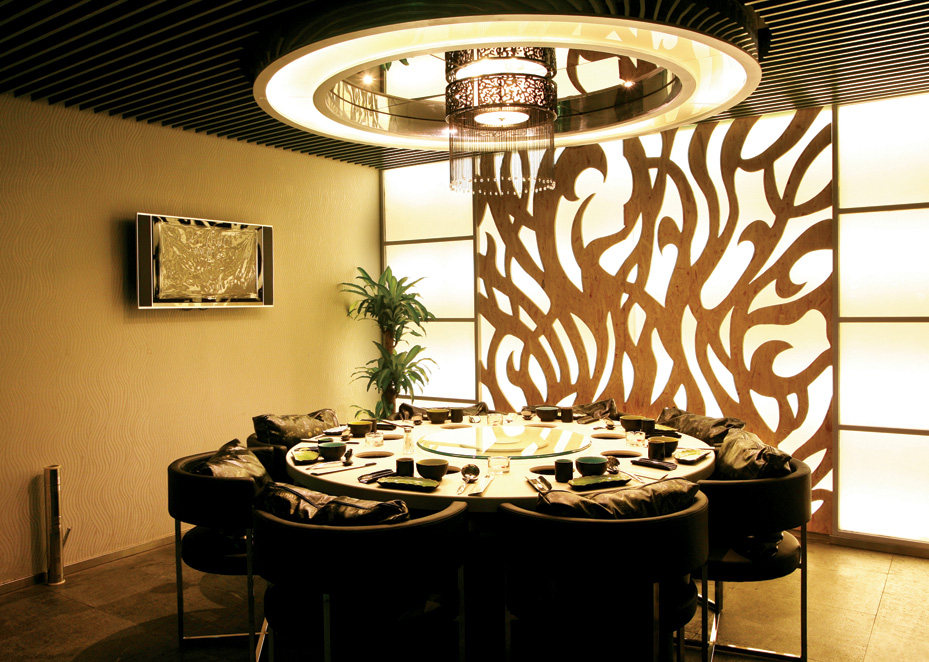 Top restaurant design 高级餐饮空间案例_味腾四海 二层包间的墙面运用了火的造型.jpg