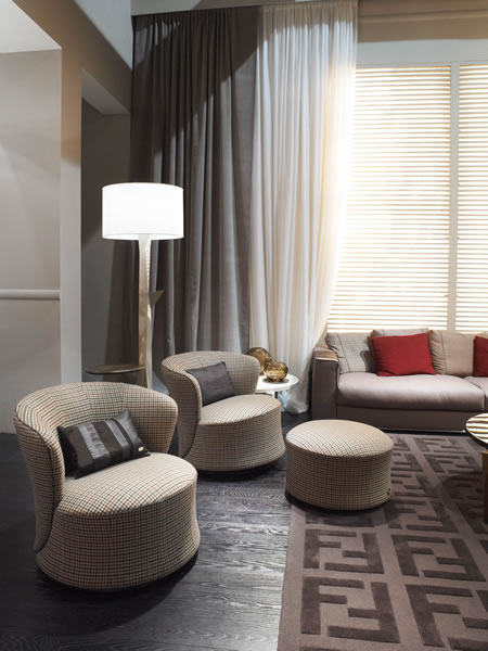FF-CASA-Tait-amchairs-with-pouf-and-Polygones-floor-lamp.jpg