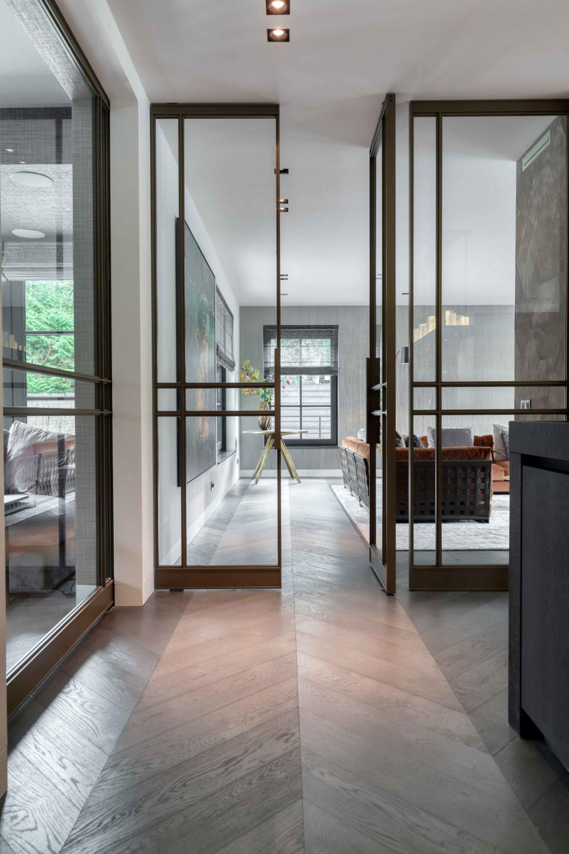 249.2-Multiple-glass-and-steel-pivot-doors-designed-by-Laska-Metaal-FritsJurgens-pivot-hinges-Inside-1-scaled.jpg